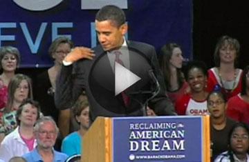 Obamabrushshouldersoff_3